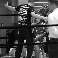 Boxing coach in action